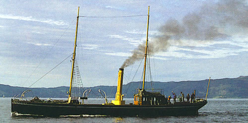 Fully restored and in steam on the Trondheimsfjord in 1993.