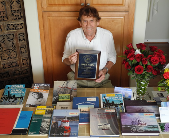 Olaf Engvig with his 2015 Outstanding Scandinavian American Award, and some of his many books and publications.